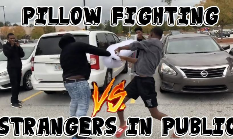 PILLOW FIGHTING STRANGERS IN PUBLIC| HOOD EDITION