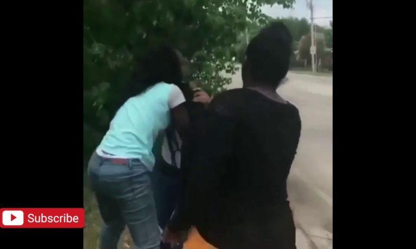 Girls fight in the street