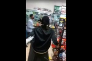 Hood fight in Milwaukee gas station